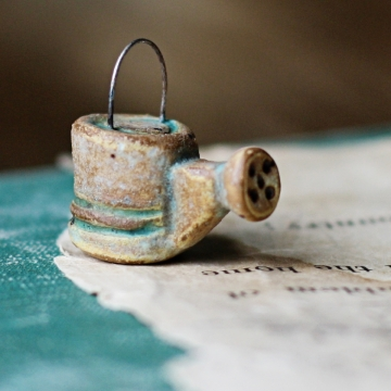 tiny weathered watering can