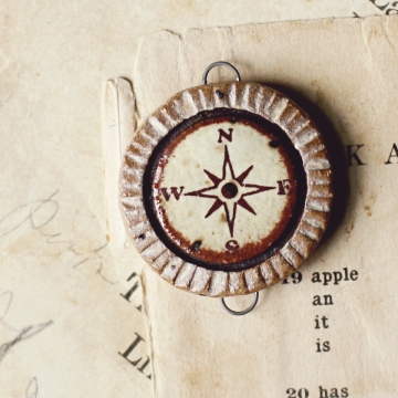 weathered compass